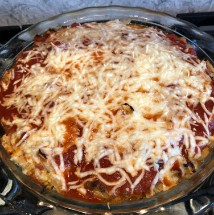 Pizza Pizzazz Turkey Meatloaf in a glass pie dish covered with melted mozzarella
