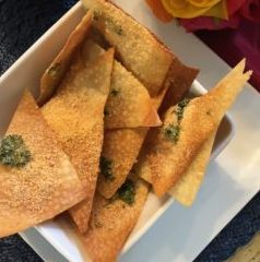 Parmesan crackers in a white bowl.