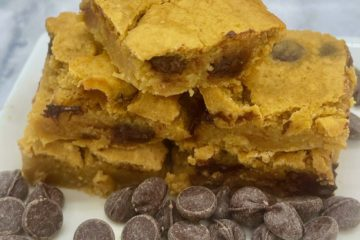 One-Point Chocolate Chip Blondies on a plate with chips